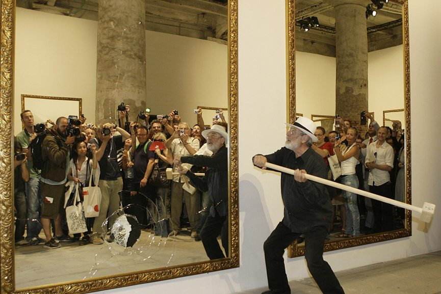 Michelangelo-Pistoletto-breaks-mirrors-during-a-performance-at-the-Arsenale-on-June-3-2009-at-the-Venice-Art-Biennale